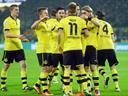 Reus treble gives Dortmund win