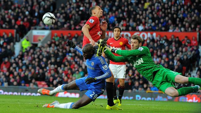 Manchester United's David De Gea and Rio Ferdinand, challenge with Chelsea's Demba Ba on FA Cup fifth round.