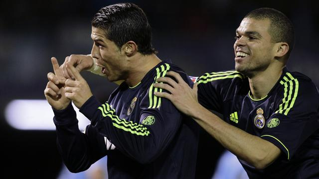 Real Madrid's Cristiano Ronaldo (L) celebrates his goal against Celta Vigo with his teammate Pepe (Reuters)