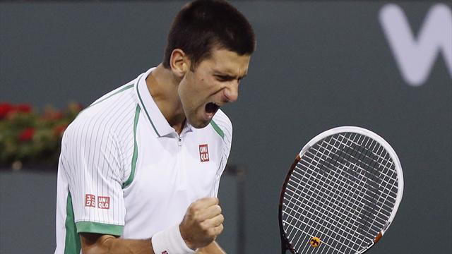 Djokovic fights through to third round