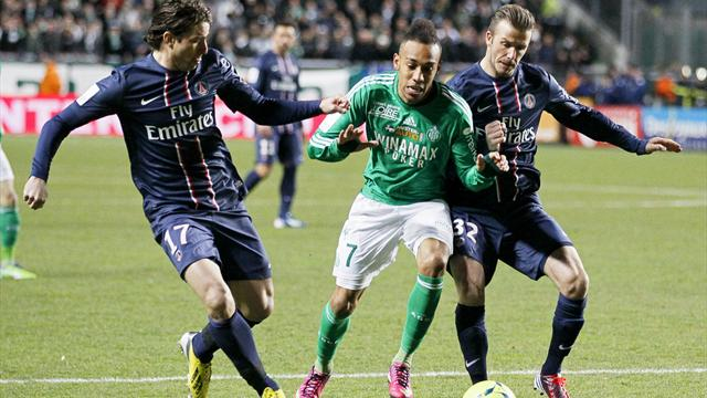 David Beckham (R) and Maxwell (L) of Paris St Germain challenge Pierre Aubameyang (C) of St Etienne during their French Ligue 1
