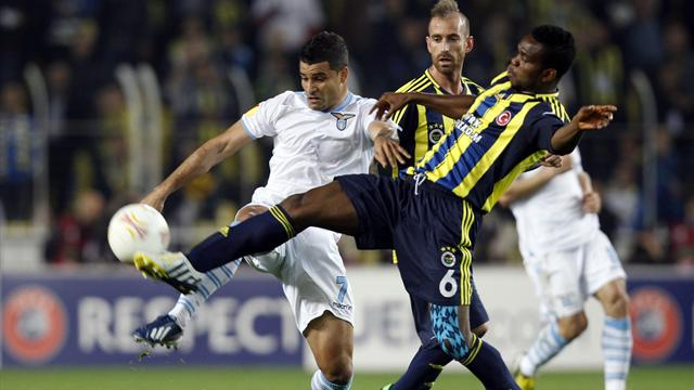 Joseph Yobo of Fenerbahce (R) challenges Ederson of Lazio (L) during their Europa League quarterfinal soccer match at Sukru Saracoglu stadium in Istanbul