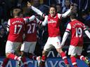 Arsenal hold off WBA despite Mertesacker red