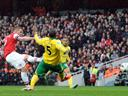 Arsenal go third as late goal rush sinks Norwich
