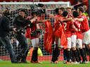 Van Persie fires Manchester United to 20th title