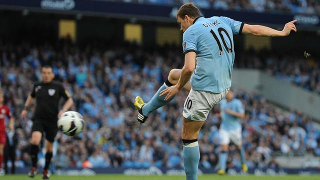 Manchester City's Bosnian forward Edin Dzeko shoots to score the opening goal during the English Premier League football match between Manchester City and West Brom on May 7 2013 (REUTERS)