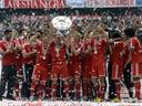 Bayern lift Bundesliga trophy after win over Augsburg