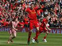 Liverpool win in Carragher's swansong