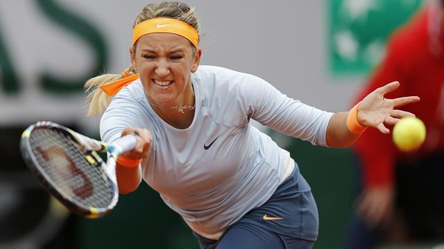 Victoria Azarenka of Belarus hits a return to Elena Vesnina of Russia during their women's singles match at the French Open (Reuters)