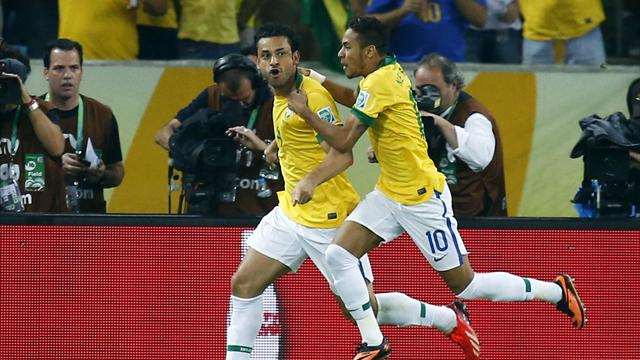 DATE IMPORTED:June 30, 2013Brazil's Fred (L) celebrates with teammate Neymar after scoring a goal against Spain during their Confederations Cup final