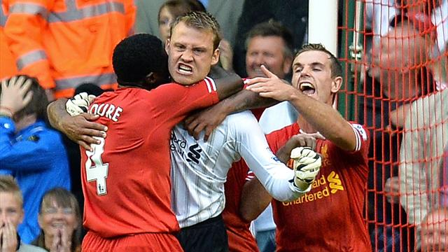 Mignolet saves late penalty as Liverpool beat Stoke