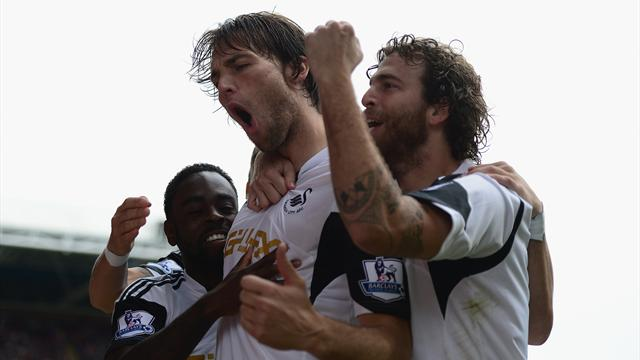 Swansea ease past poor Palace