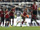 Juve beat Milan to maintain unbeaten run