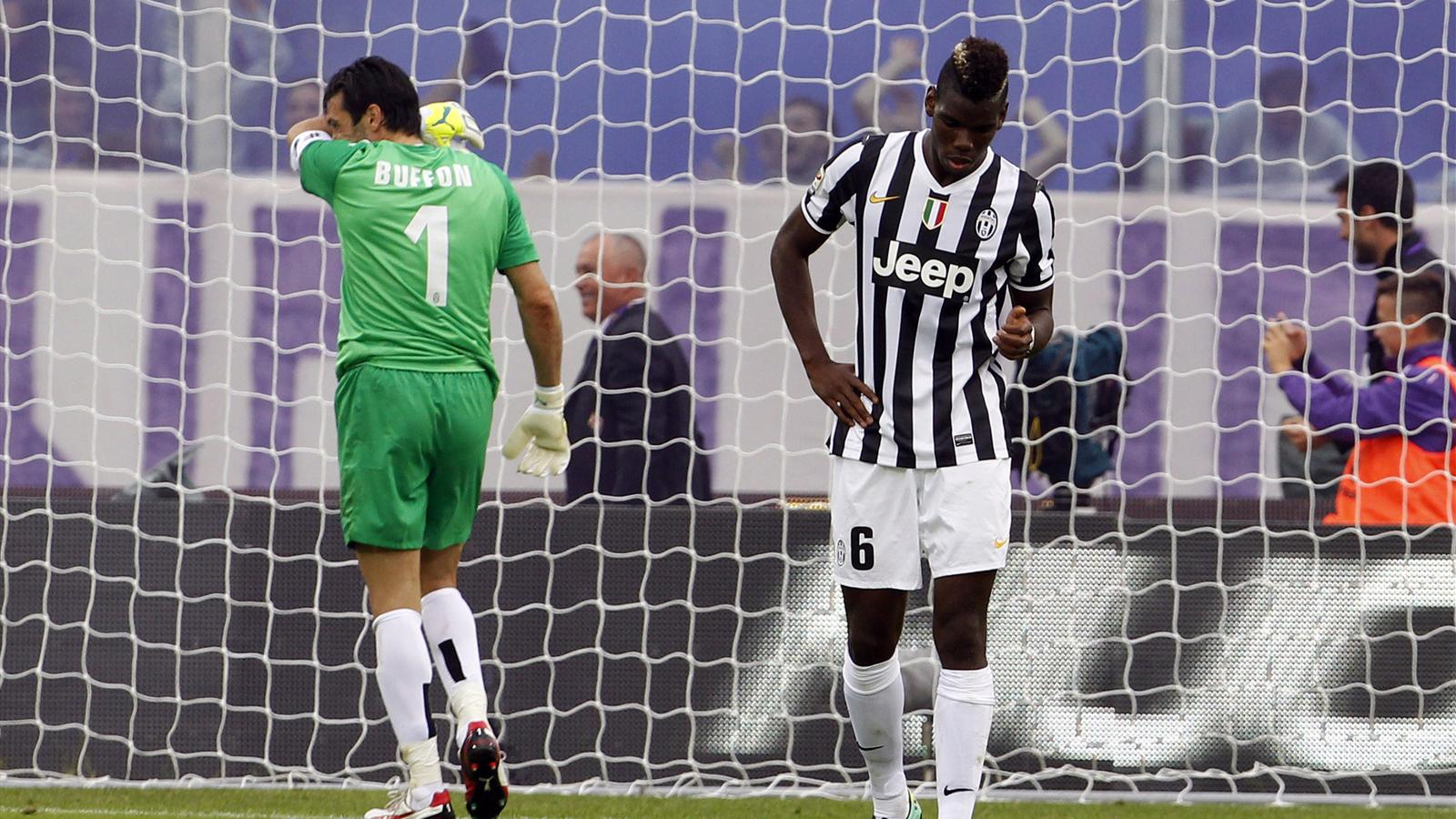 Juventus' goalkeeper Gianluigi Buffon (L) and Paul Pogba react after Fiorentina's Joaquin Sanchez (not pictured) scored during their Italian Serie A soccer match at the Artemio Franchi stadium in Florence October 20, 2013. (Reuters)
