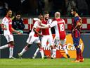 Ten-man Ajax hold on to beat Barcelona