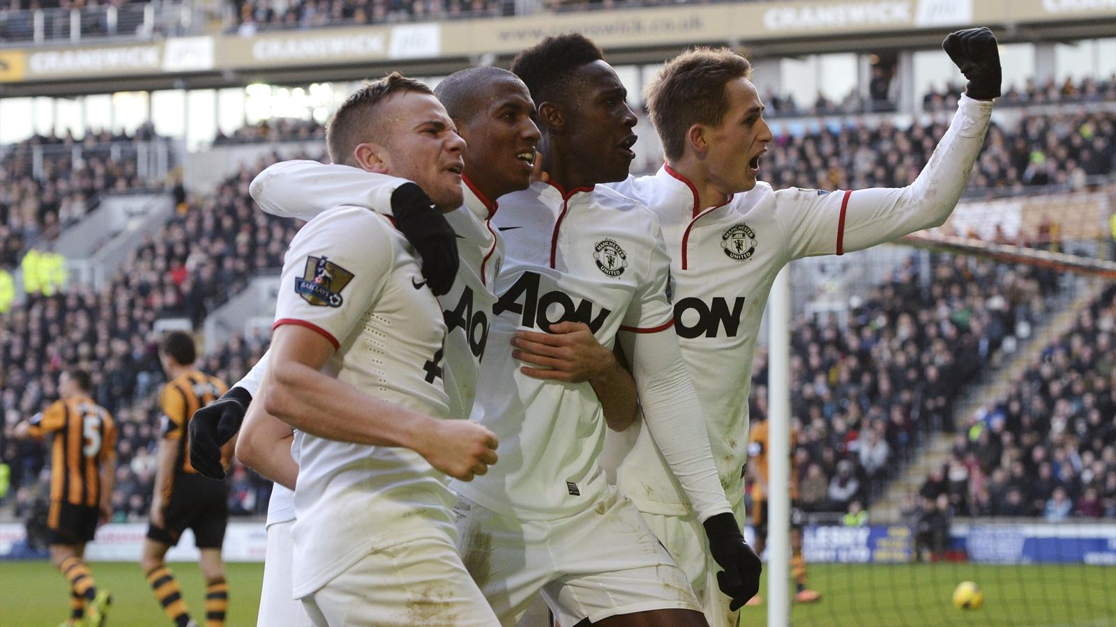 Manchester United players (L-R) Tom Cleverley, Ashley Young, Danny Welbeck and Adnan Januzaj celebrate