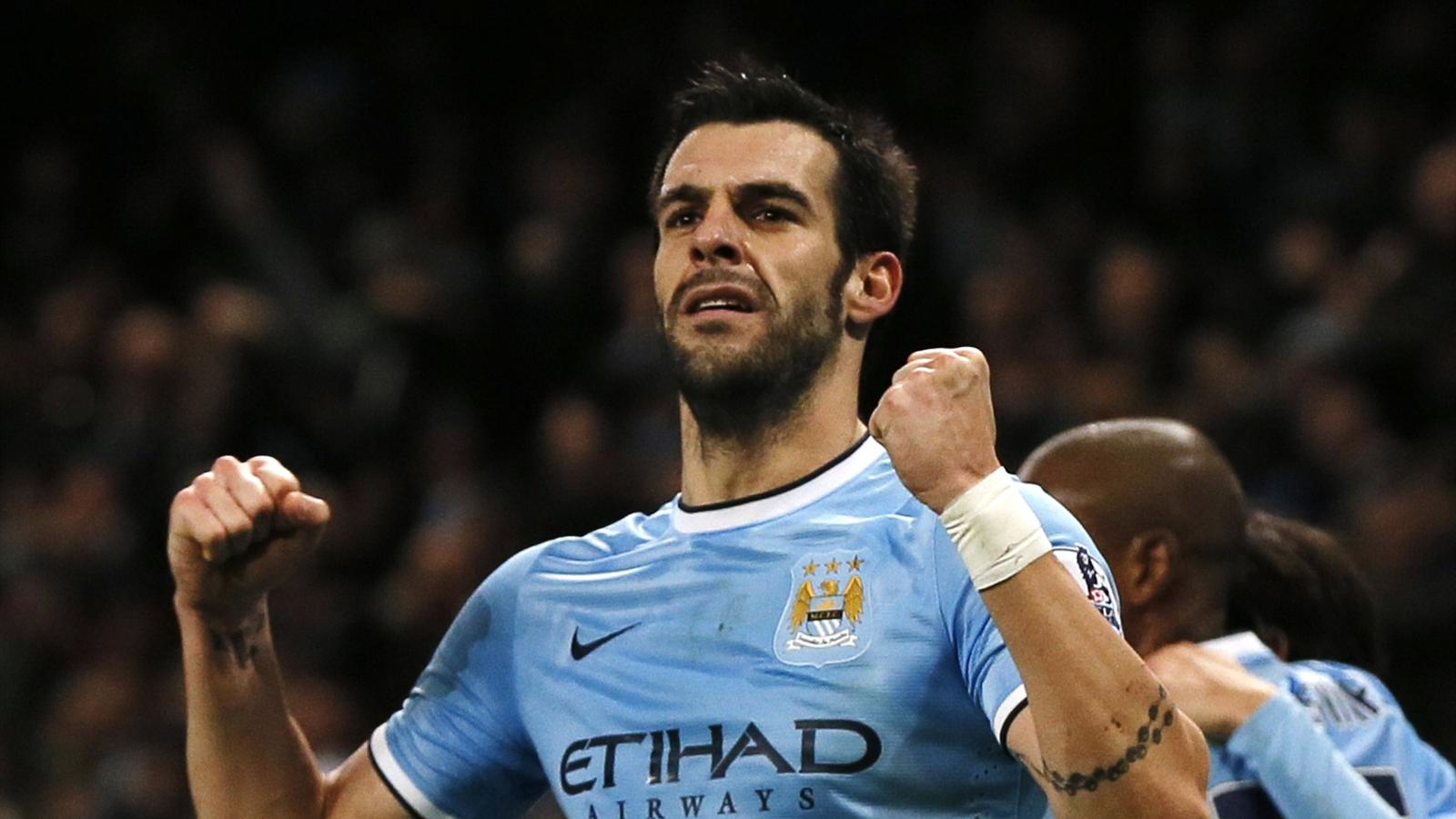 Manchester City's Alvaro Negredo celebrates after scoring a goal against Liverpool during their English Premier League match at the Etihad, December 26, 2013 (Reuters)