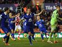 Baines penalty salvages point for Everton at Stoke