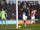 Liverpool edge out Stoke in eight goal thriller