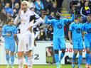 Tottenham hit three to beat poor Swansea