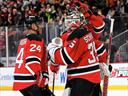 Schneider stars as Devils hold off Capitals