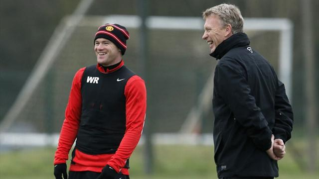 Manchester United's manager David Moyes and Wayne Rooney during a training session (Reuters)