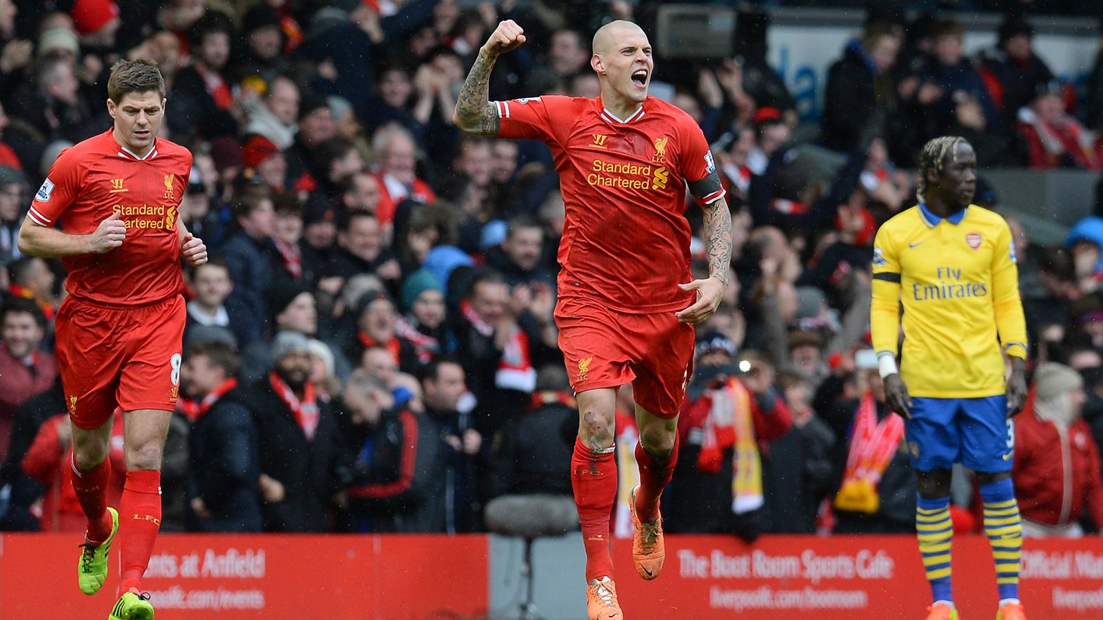 Martin Skrtel celebrates putting Liverpool ahead after a minute against Arsenal (AFP)