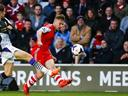 Henderson plays down title talk