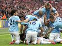 City battle back to triumph at Wembley