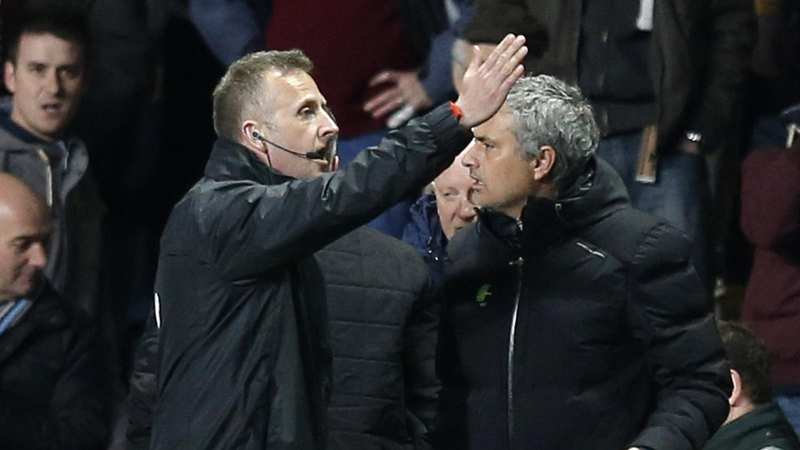 Chelsea manager Jose Mourinho (R) is directed out of the dugout by fourth official Jonathan Moss (Reuters)