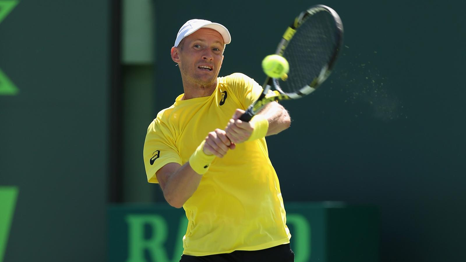 Nikolay Davydenko of Russia plays a backhand against Adrian Mannarino of France during their first round match at the Sony Open at Crandon Park Tennis Center (AFP)