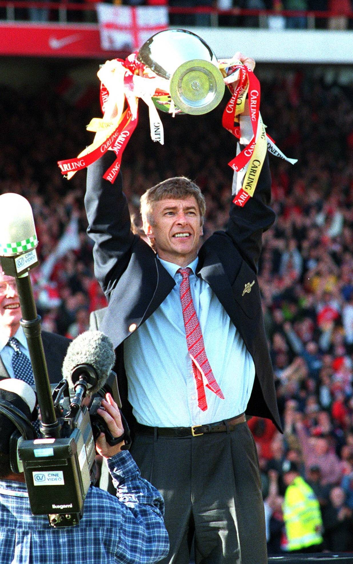 Wenger with a trophy in 1998