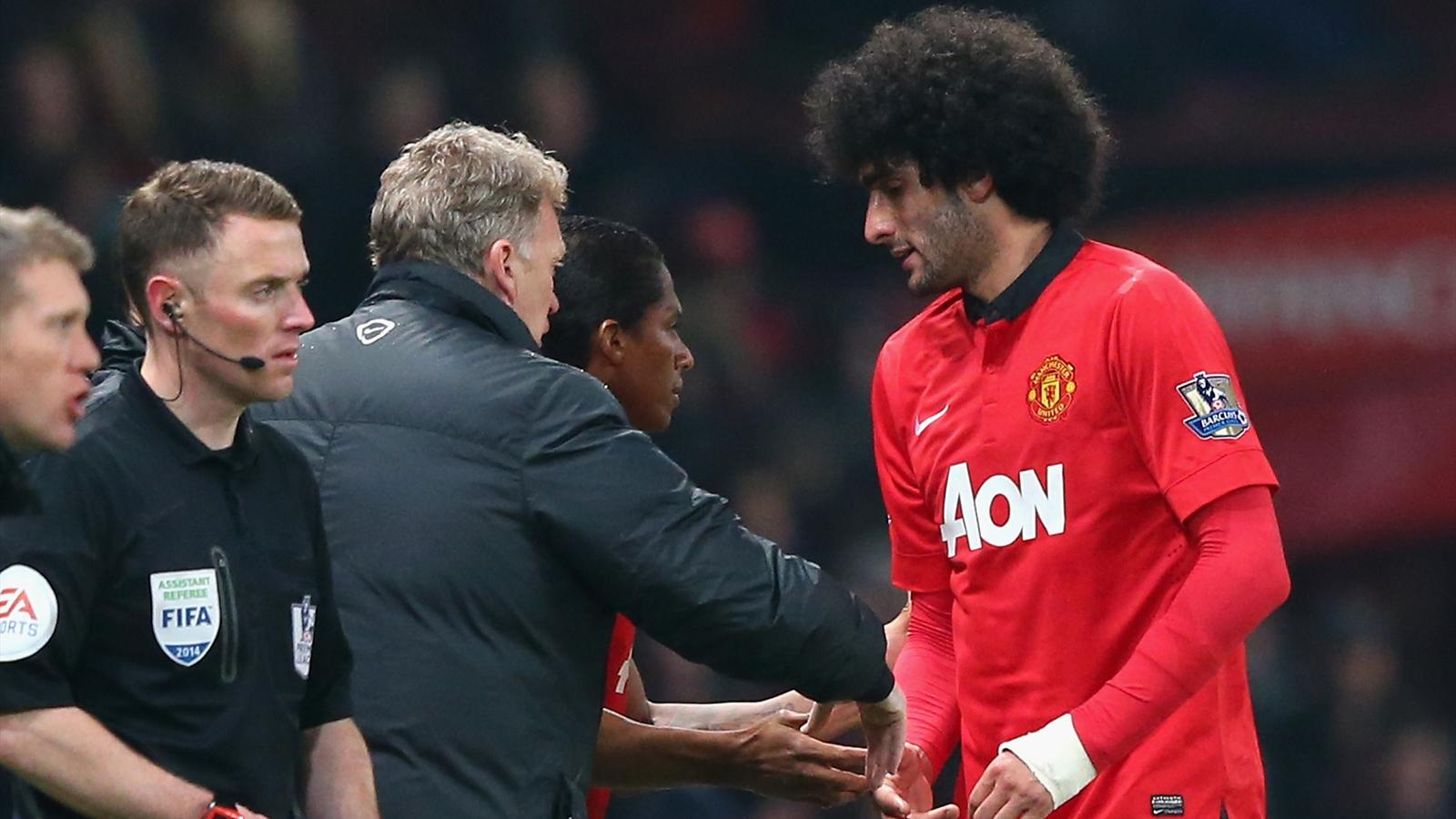 Marouane Fellaini of Manchester United is substituted by Manager David Moyes