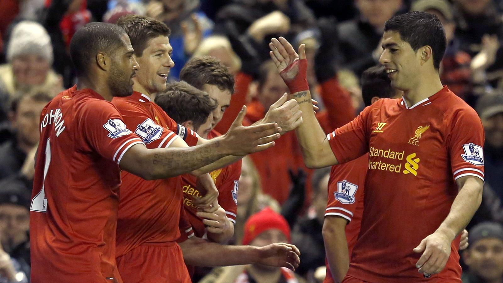 Liverpool's Steven Gerrard (L) celebrates with teammate Luis Suarez (R) after scoring a goal during their English Premier League (Reuters)