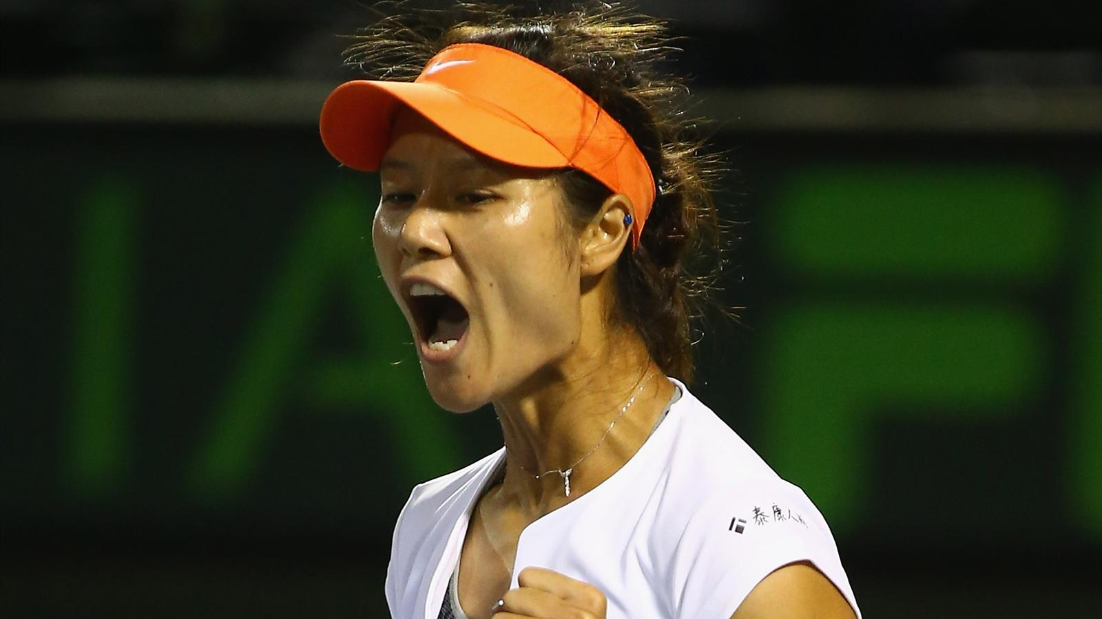 Li Na of China celebrates winning the first set against Dominika Cibulkova of Slovakia at the Sony Open in Miami (AFP)