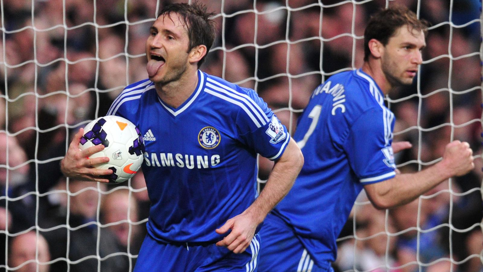 Frank Lampard celebrates scoring for Chelsea against Stoke (AFP)
