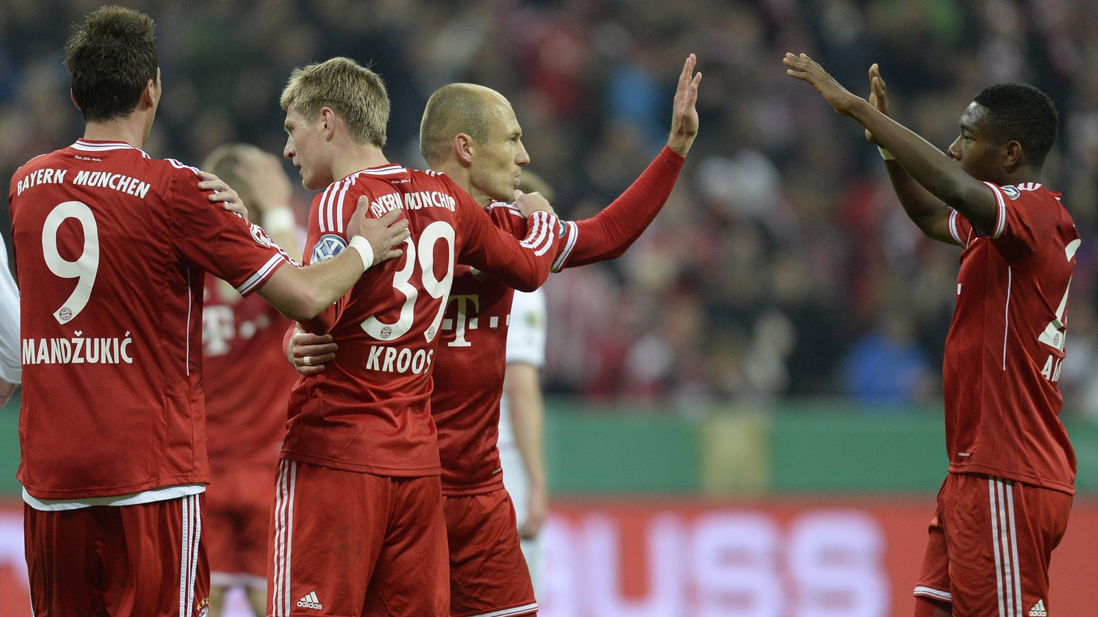 Bayern Munich's Croatian striker Mario Mandzukic, Bayern Munich's midfielder Toni Kroos, Bayern Munich's Dutch midfielder Arjen Robben and Bayern Munich's Austrain midfielder David Alaba celebrate after the second goal during the German Cup (DFB Pokal)