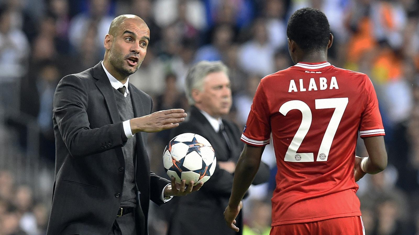 Bayern Munich's Spanish head coach Pep Guardiola (L) gives instructions to Bayern Munich's Austrian midfielder David Alaba