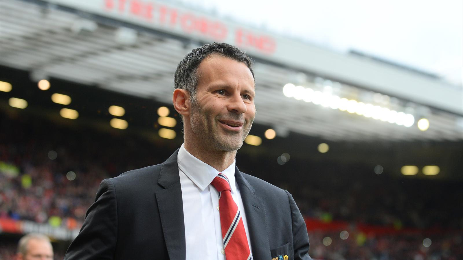 Ryan Giggs, happy during his first game with Manchester United