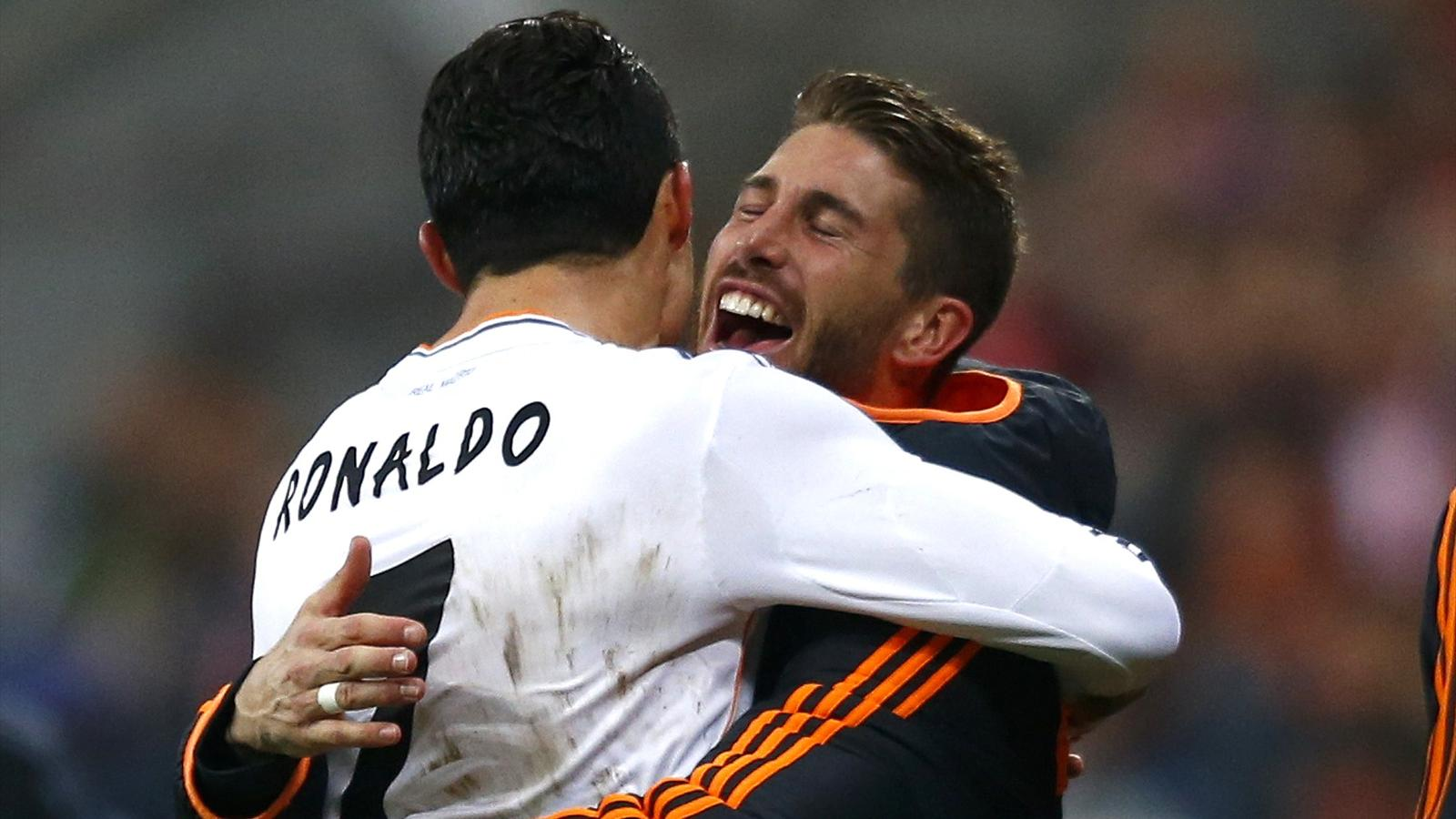 Real Madrid's Cristiano Ronaldo celebrates the fourth goal against Bayern Munich with Sergio Ramos (R) during their Champions League semi-final second leg soccer match in Munich, April 29, 2014. REUTERS/Michael Dalder (GERMANY - Tags: SPORT SOCCER TPX IMA