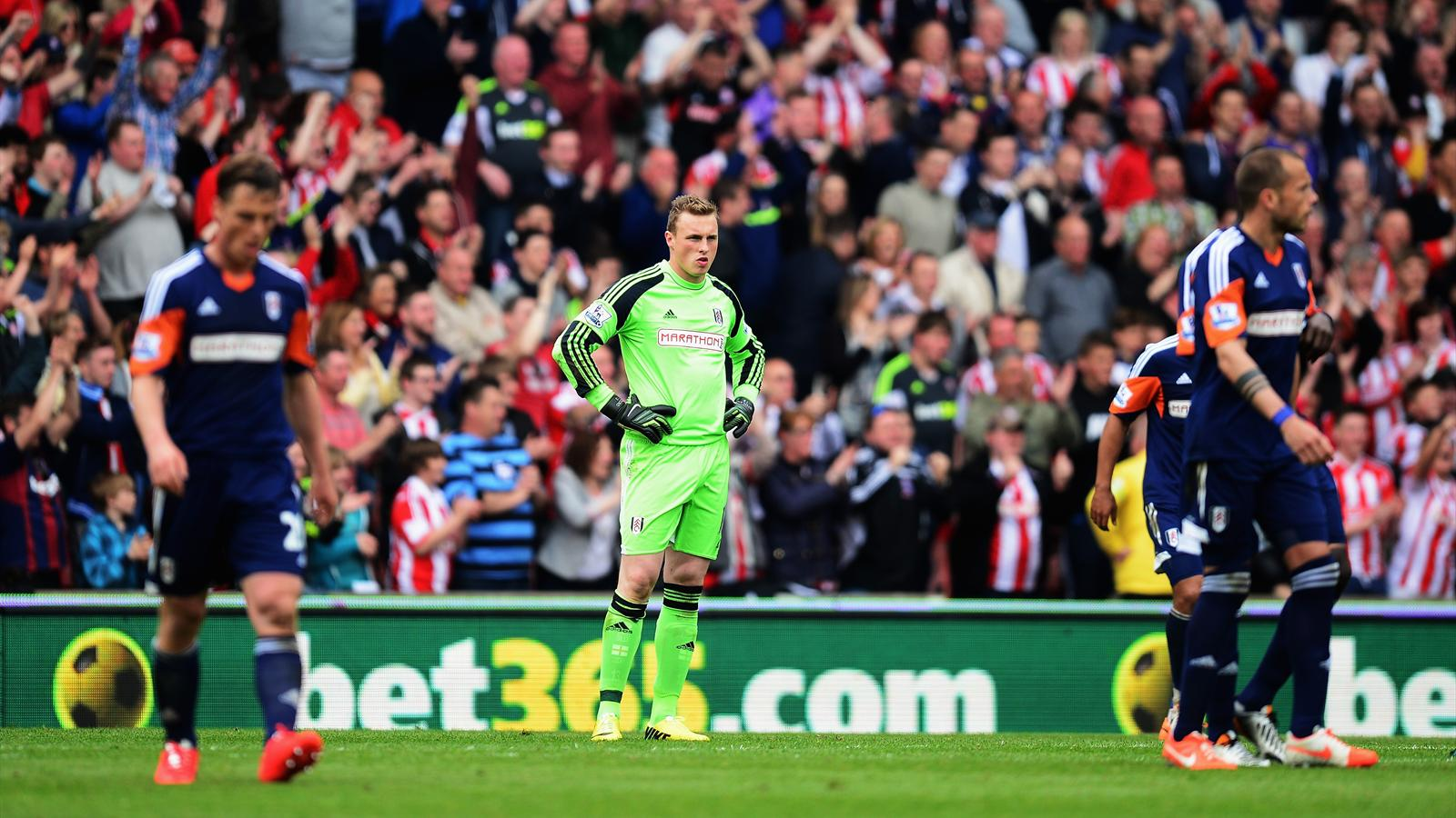 David Stockdale the Fulham goalkeeper reacts after conceding a goal during the Barclays Premier League match between Stoke City and Fulham at the Britannia Stadium