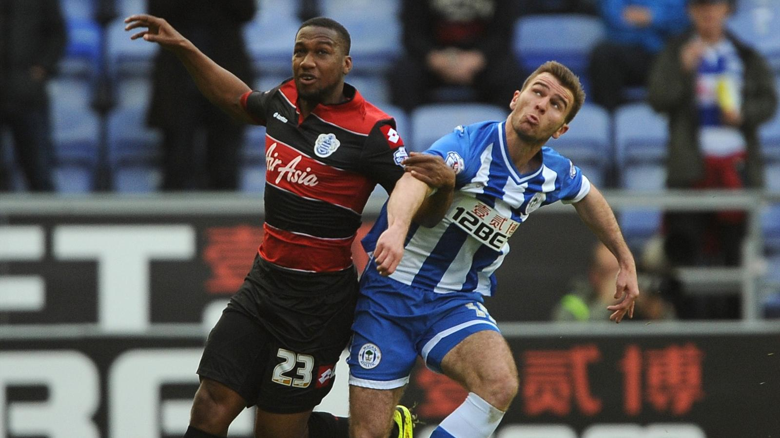 Wigan Athletic's Callum McManaman (right) and Queens Park Rangers' Junior Hoilett (left) battle for the ball. (PA)