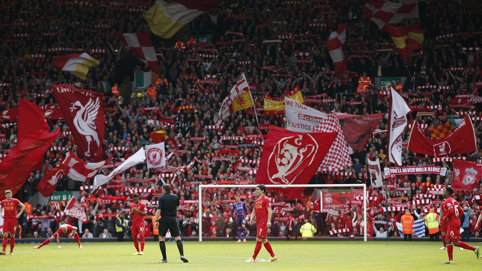 Liverpool fans show their support at the Kop end of Anfield ahead of the English Premier League ...