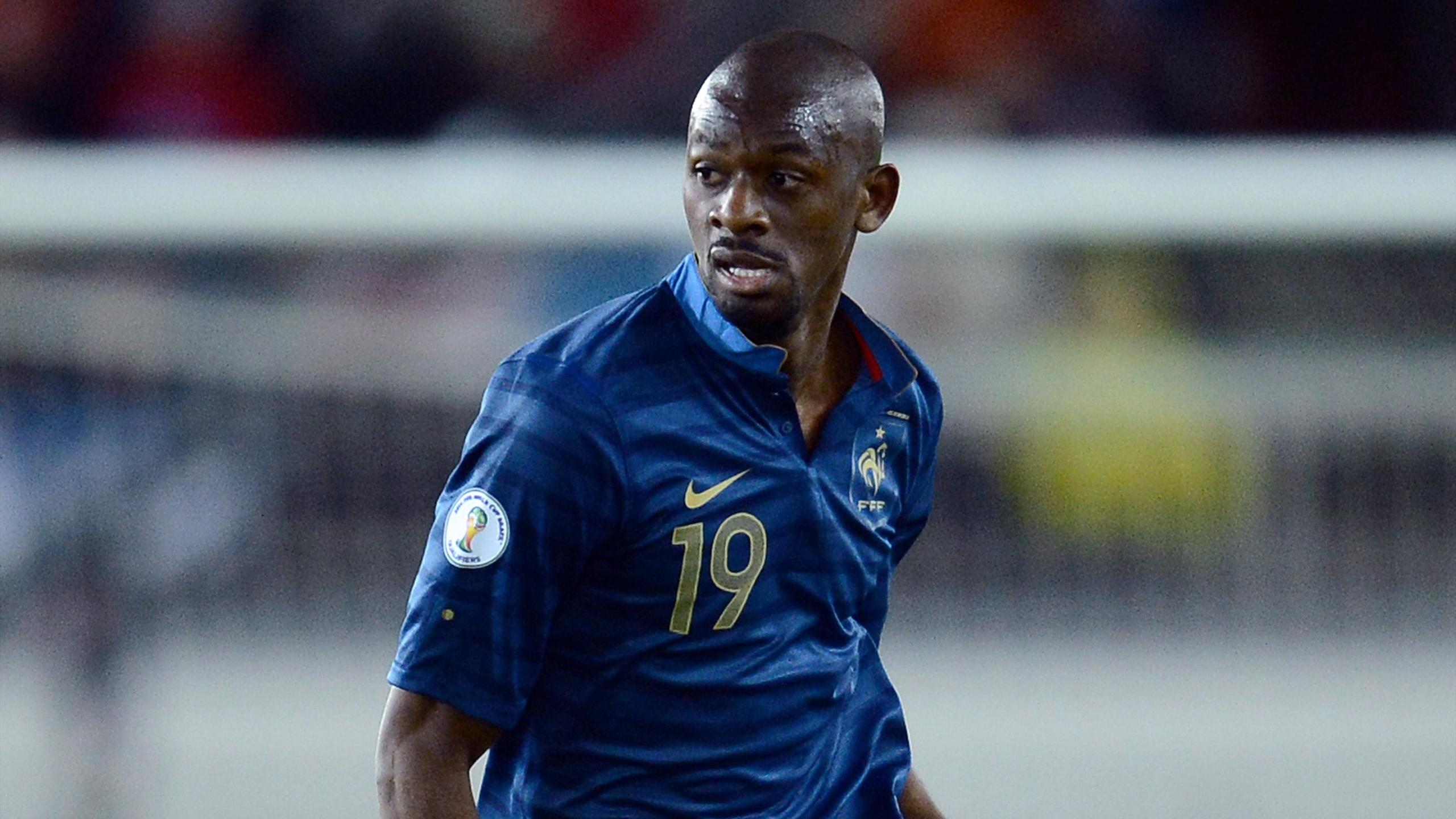 French midfielder Abou Diaby runs with the ball during the World Cup 2014 qualifying football match Finland vs France, on September 7, 2012 at the Olympic Stadium in Helsinki.