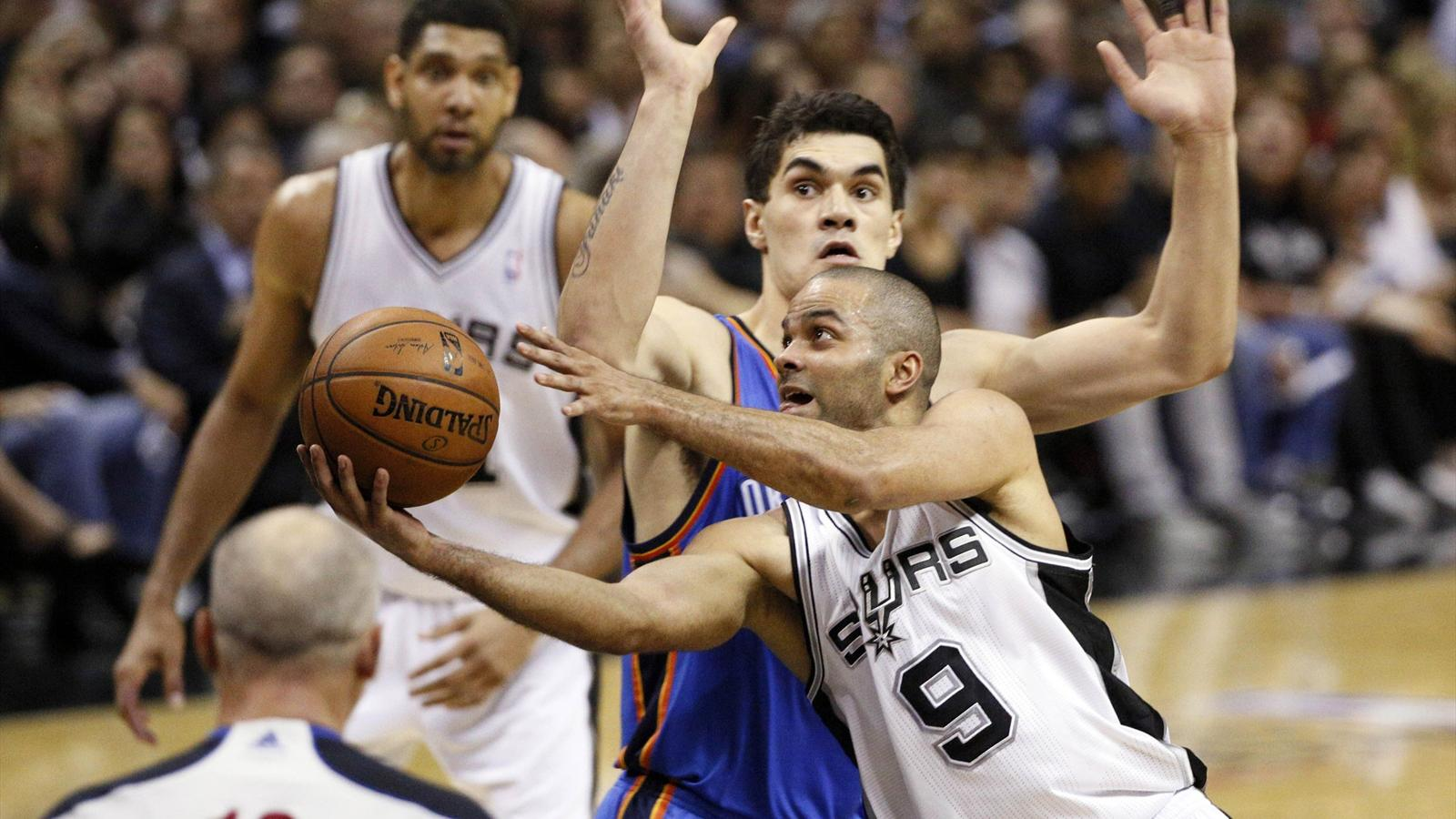 San Antonio Spurs guard Tony Parker (9) drives past Oklahoma City Thunder center Steven Adams