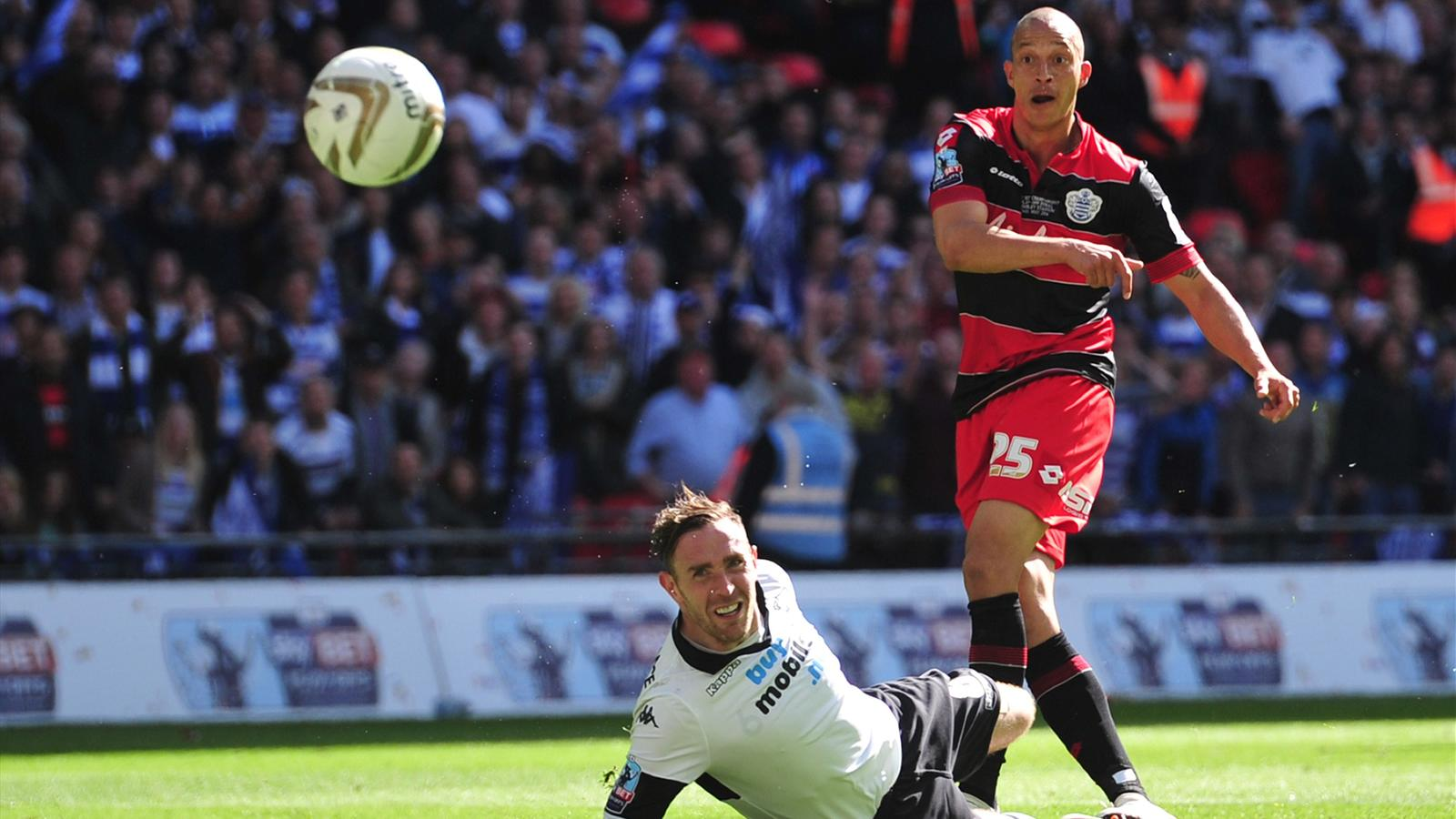 : QPR's English striker Bobby Zamora scores the opening goal during the English Championship Play Off final football match between Derby County and Queens Park Rangers at Wembley Stadium in London on May 24, 2014.