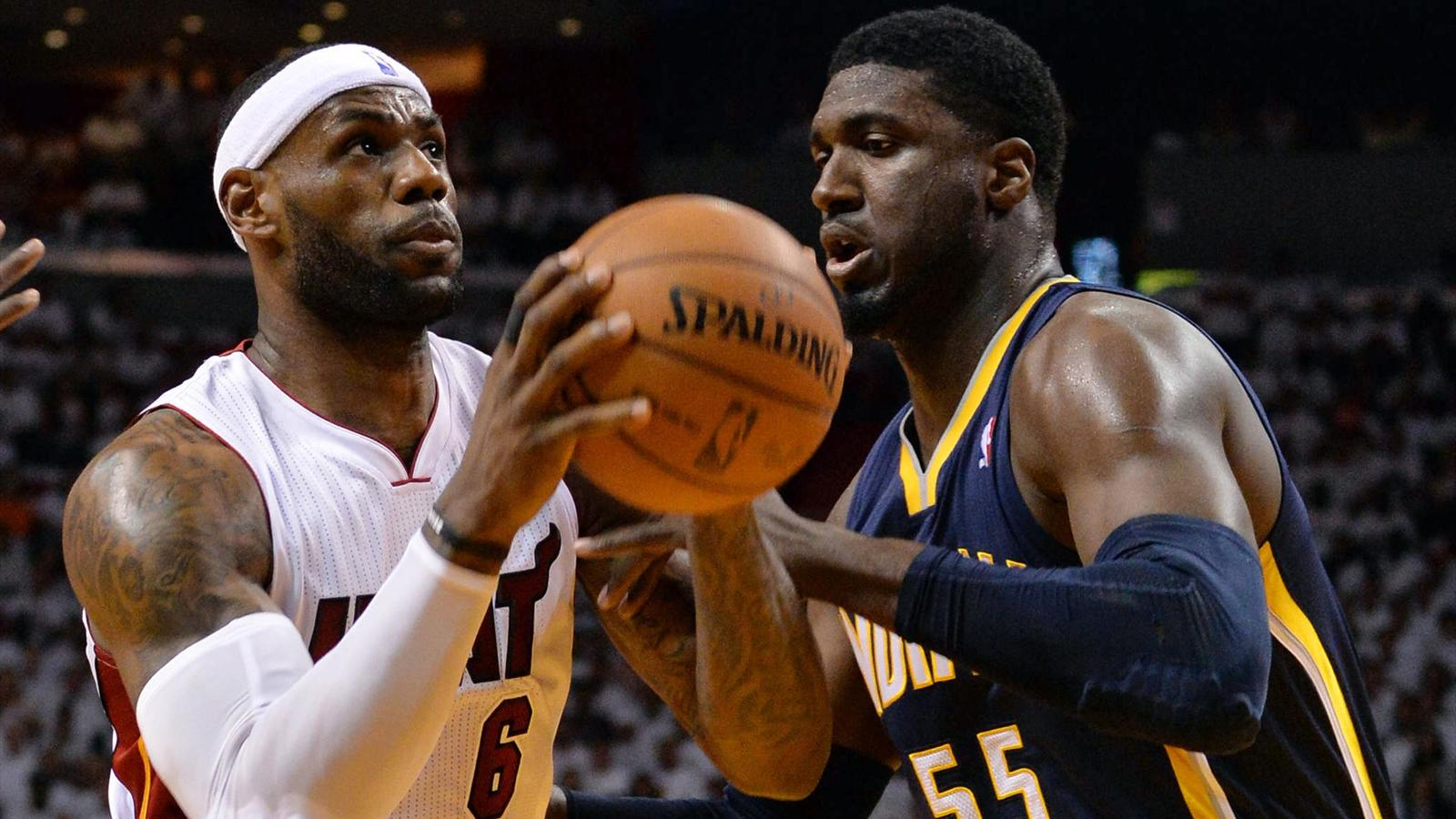 Miami Heat forward LeBron James (6) drives to the basket against Indiana Pacers center Roy Hibbert (55) (Reuters)