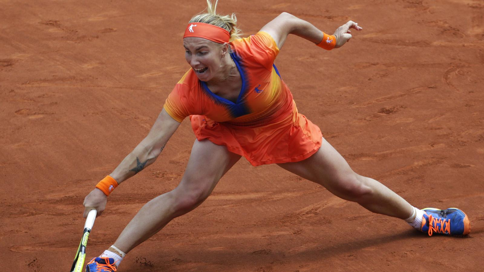 Czech Republic's Petra Kvitova hits a return to Russia's Svetlana Kuznetsova during their French tennis Open