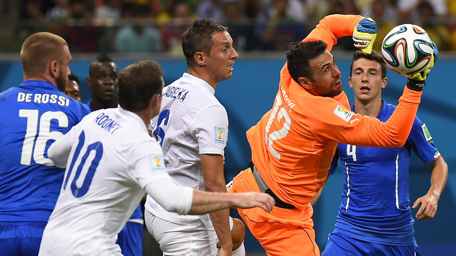 BRAZIL, Manaus : Italy's goalkeeper Salvatore Sirigu (2R) saves the ball during a Group D football match between England and Italy at the Amazonia Arena in Manaus during the 2014 FIFA World Cup on June 14, 2014. AFP PHOTO / FABRICE COFFRINI