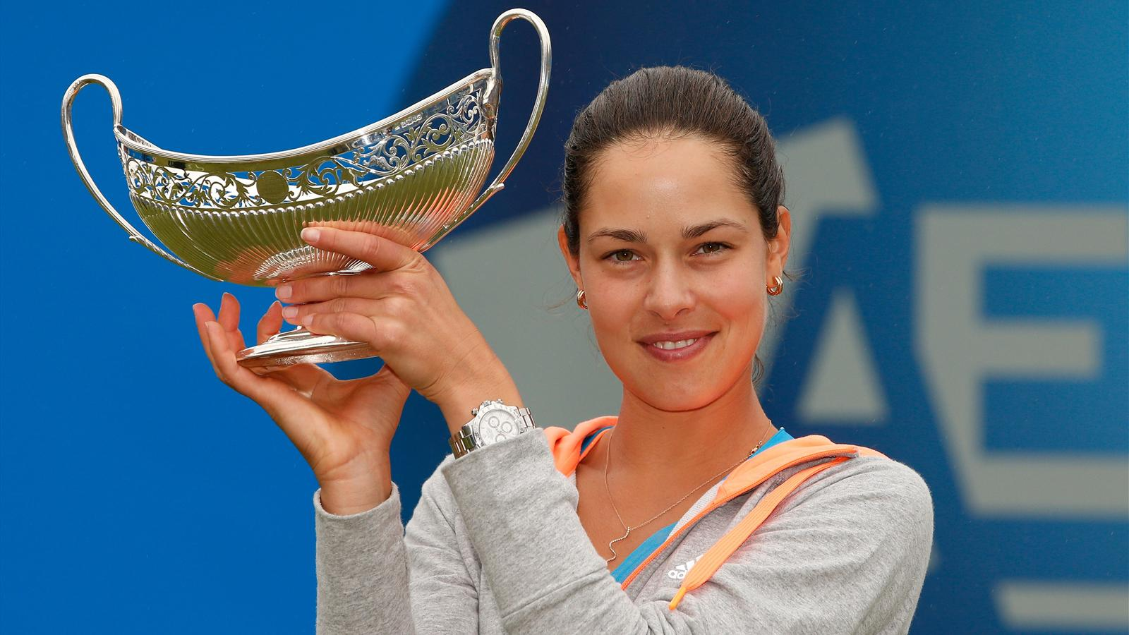 Ana Ivanovic of Serbia holds up the Maud Watson trophy after beating Barbora Zahlavova Strycova of Czech Republic in the final of the WTA AEGON Classic (AFP)